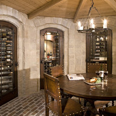 Traditional Wine Cellar by Eskuche Design