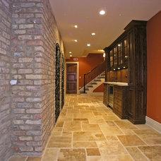 Traditional Wine Cellar by Distinctive Custom Homes, Inc.