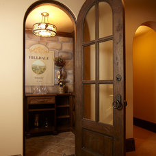 Traditional Wine Cellar by Schrader & Companies