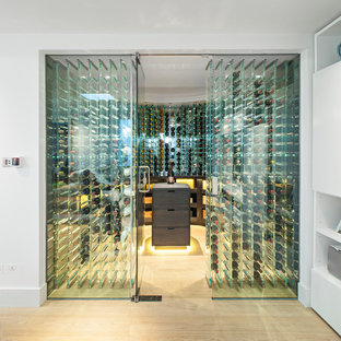 Inspiration for a contemporary wine cellar in London with light hardwood flooring and storage racks.