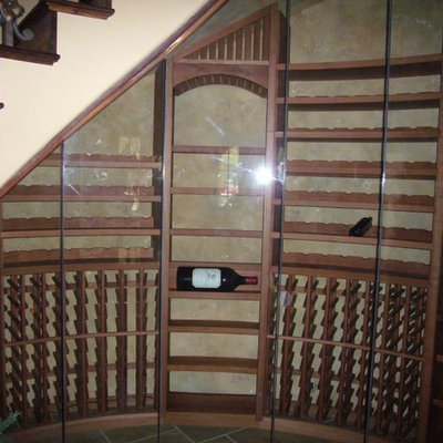 Inspiration for a large craftsman wine cellar remodel in Sacramento with storage racks