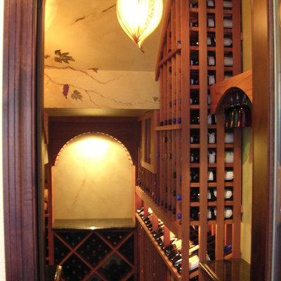 Wine cellar - large craftsman wine cellar idea in Sacramento with storage racks