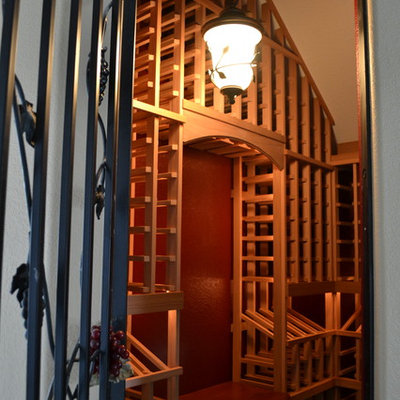 Wine cellar - mid-sized craftsman wine cellar idea in Sacramento with storage racks