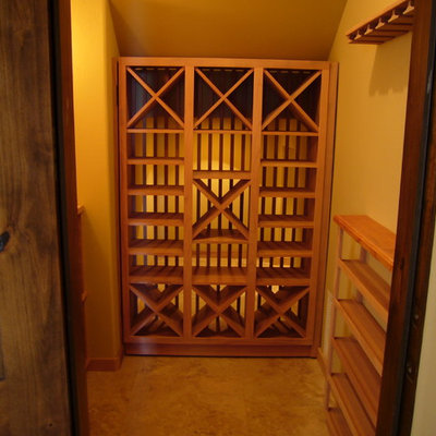 Wine cellar - mid-sized craftsman wine cellar idea in Sacramento with diamond bins