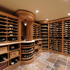 Traditional Wine Cellar by Revel Custom Wine Cellars