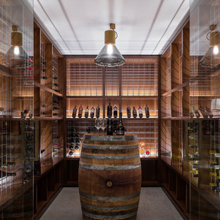 Contemporary wine cellar in Sydney with storage racks and beige floor.