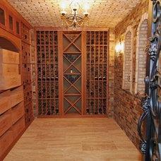 Mediterranean Wine Cellar by Keystone Design Build, Inc.
