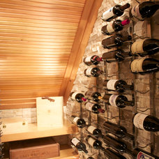 Contemporary Wine Cellar by Realstone Systems