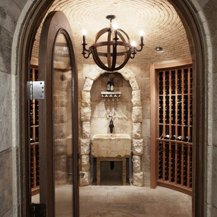 Example of a tuscan wine cellar design in Orange County