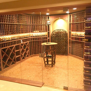 Inspiration for a medium sized contemporary wine cellar in St Louis with cork flooring and storage racks.
