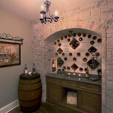 Traditional Wine Cellar by Summit Signature Homes, Inc.