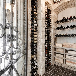Inspiration for a mediterranean wine cellar remodel in Houston with display racks