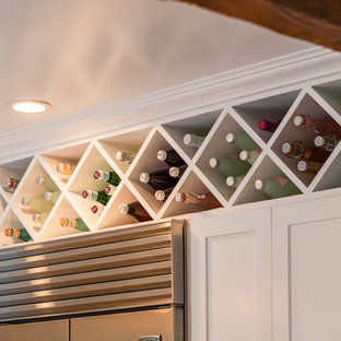 Inspiration for a small midcentury wine cellar in Santa Barbara with storage racks.
