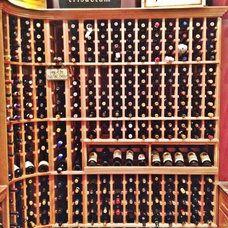 Traditional Wine Cellar by Tatum Building Corp