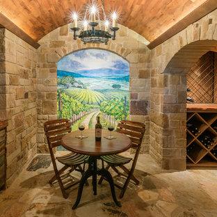 Idéer för att renovera en mellanstor medelhavsstil vinkällare, med kalkstensgolv och vinställ med diagonal vinförvaring