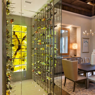 This is an example of a large classic wine cellar in Tampa with porcelain flooring, storage racks and beige floors.