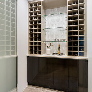 Photo of a small contemporary wine cellar in Perth with porcelain flooring and display racks.