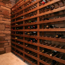 Mediterranean Wine Cellar by Charles Ayers Construction, Inc.