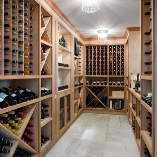 Wine cellar - transitional marble floor wine cellar idea in Toronto with storage racks