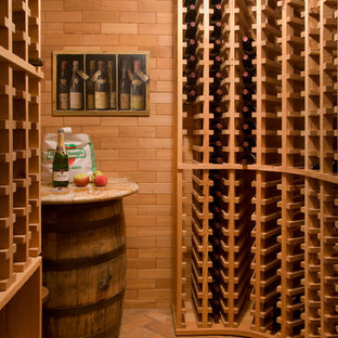 Inspiration for a large traditional wine cellar in Boston with brick flooring and storage racks.