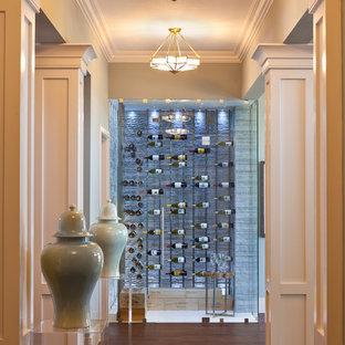 Ejemplo de bodega contemporánea, grande, con suelo de mármol, botelleros y suelo beige