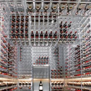 Ejemplo de bodega moderna, grande, con suelo de linóleo, botelleros y suelo blanco