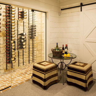 Example of a mid-sized country brick floor wine cellar design in Minneapolis with display racks