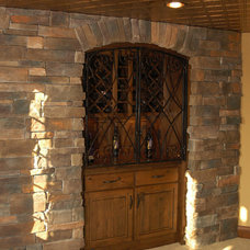 Traditional Wine Cellar by Toebben Builders