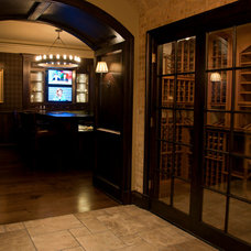 Traditional Wine Cellar by Hooked Up Installs, Inc