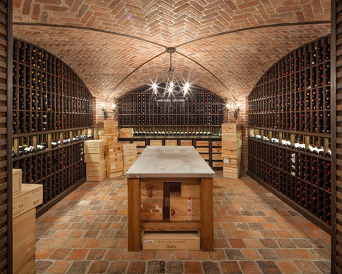 Traditional Brick Floor Wine Cellar Idea In New York With Storage Racks