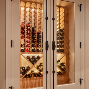 Design ideas for a classic wine cellar in Milwaukee with storage racks and vinyl flooring.