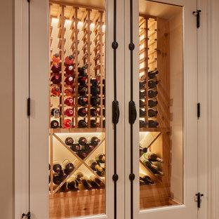 Réalisation d'une cave à vin tradition avec des casiers et un sol en vinyl.