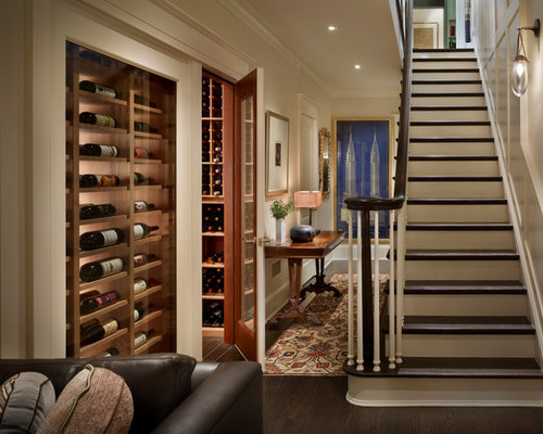 example of a classic dark wood floor and brown floor wine cellar design in new york - Wine Cellar Design Ideas