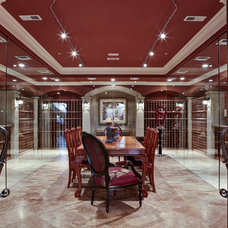 Traditional Wine Cellar by J. Hettinger Interiors