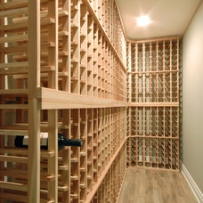 Traditional Wine Cellar by Kastler Construction