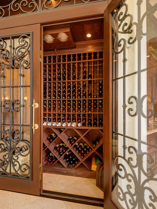 Wrought iron wine cellar door houzz Turn closet into wine cellar