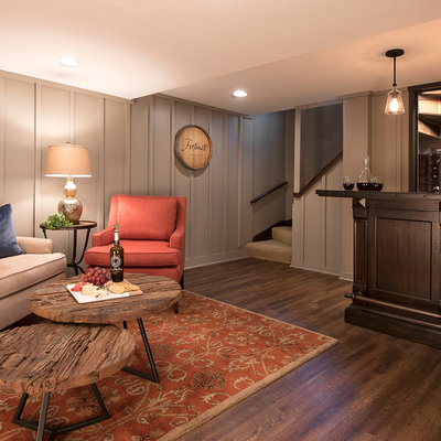 Inspiration for a mid-sized timeless dark wood floor wine cellar remodel in Milwaukee with storage racks