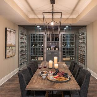 Foto de bodega campestre con suelo de madera en tonos medios y botelleros