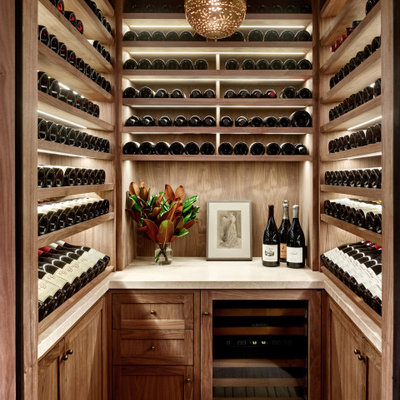 Example of a transitional beige floor wine cellar design in San Francisco with display racks