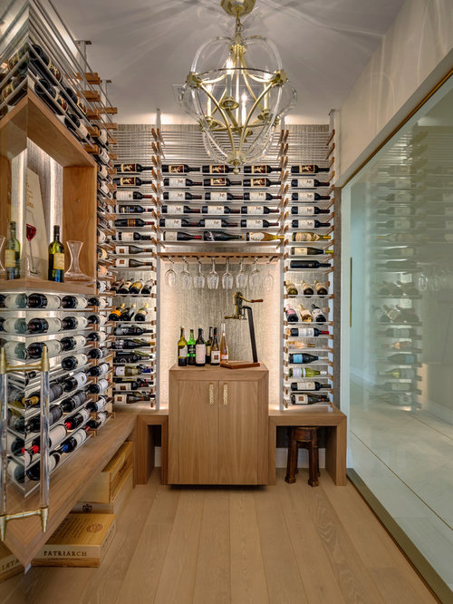 Example Of A Mid Sized Trendy Light Wood Floor And Beige Floor Wine Cellar  Design