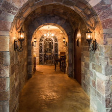 Traditional Wine Cellar by Wayne Bernskoetter Construction