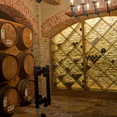 Mediterranean Wine Cellar by Great  Falls Distinctive Interiors Inc.