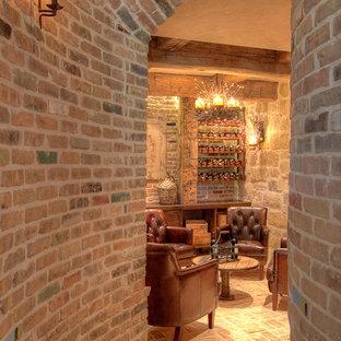 Example of a tuscan brick floor wine cellar design in Houston with storage racks