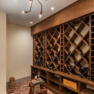 Idéer för en stor medelhavsstil vinkällare, med tegelgolv, vinställ med diagonal vinförvaring och rosa golv