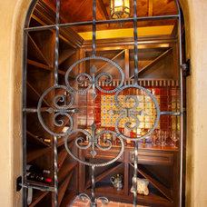 Mediterranean Wine Cellar by Jim Boles Custom Homes
