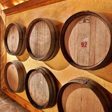 Mediterranean Wine Cellar by Teakwood Builders, Inc.