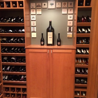 Inspiration for a small midcentury wine cellar in Salt Lake City with light hardwood flooring, storage racks and beige floors.
