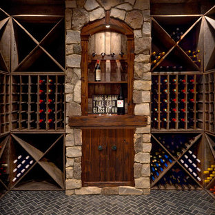 Large transitional brick floor and gray floor wine cellar photo in Detroit with storage racks