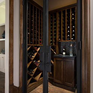 Small elegant dark wood floor wine cellar photo in Dallas with diamond bins