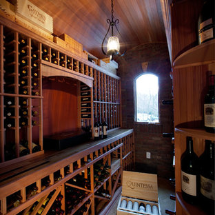 This is an example of a classic wine cellar in Charlotte with storage racks.